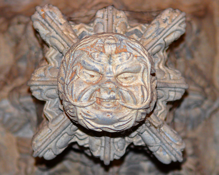 This is a photograph of one of fifty Green Man heads throughout Rosslyn Chapel in Orkney, Scotland (5/06).  This chapel is famous within a portion of the Da Vinci Code book and movie.