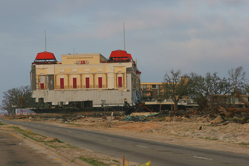 This picture was taken in Gulfport, MS area.  The buildling was a floating casino that was positioned in the gulf prior to Katrina washing it up on shore.  The flattend buildling on the right was a Holiday Inn.  During the storm surge when this casino smashed into the motel, several people died.