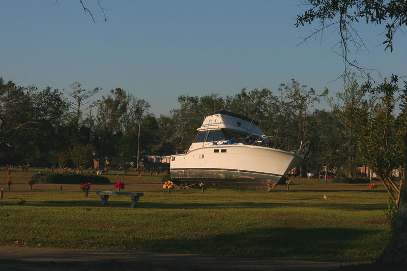 As you can see from the pictures, boats where found everywhere due to massive storm surge.  This picture of a larger boat that was deposited in a cemetery in Gulfport, MS.  Unfortunately many caskets were floated out of the mausoleums and a tempoary storage facility had to be established for identification and eventual return.