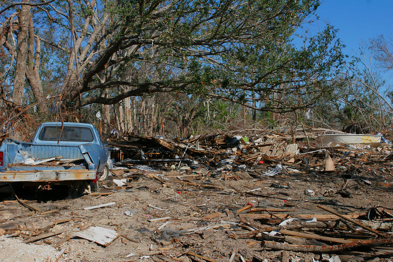 Unfortunately this is what you would see all along the Mississippi coast.  Debris in what used to be someone's home with scattered boats and smashed vehicles.  This picture was taken in the Bay St. Louis area.
