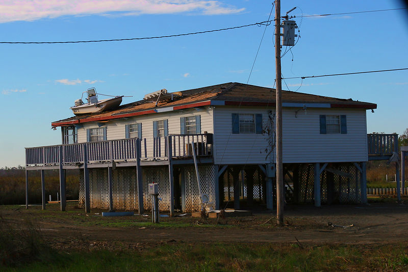 This picture was taken in the Waveland, MS area.  This house is located approximately 5 miles inland.  With the Carolina Skiff and debris situated on the roof, it certainly gives you an idea of the height of the storm surge.