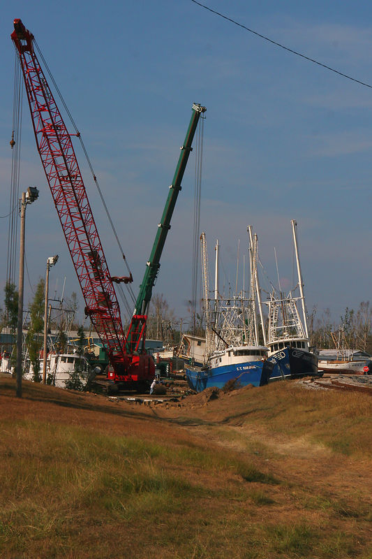 These large shrimp boats were lifted by the storm surge and dropped onto the railroad tracks.  One shrimp boat not pictured ended up in the middle of a wooded area.