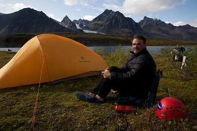Quintessential Mark Stevens relaxing in Sled Pass - way deep in the Alaska wilderness.  Revelation Mountains, Alaska.