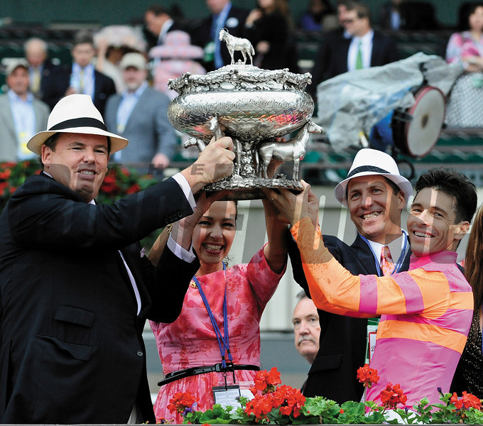 George Hall, left lifts the winner's trophy with the aid of his wife Lori, his trainer Kelly Breen, second from right and jockey Jose Valdivia Jr. after his horse Ruler On Ice won  the 143rd running of the Belmont Stakes at  Belmont Park in Elmont, N.Y. June 11, 2011.    <br /> Photo by: Skip Dickstein