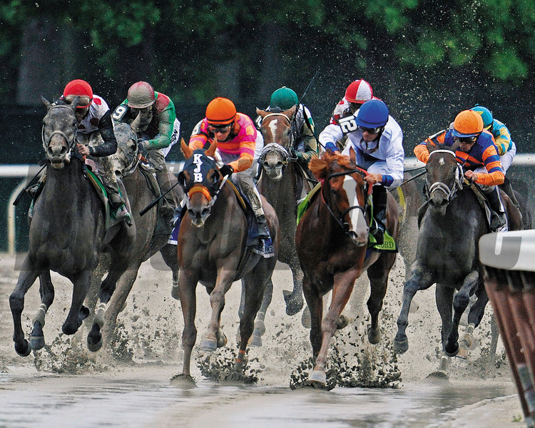 Ruler On Ice turning for home in the Belmont Stakes 2011<br /> Photo by: Mathea Kelley