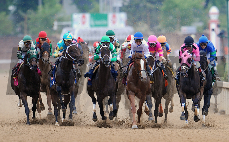 Eventual fourth place finisher Shackleford (blue cap, blaze face) leads the field the first time by the stands.<br /> Eventual winner Animal Kingdom is second from the left in the red cap.<br /> Photo by: Rick Samuels