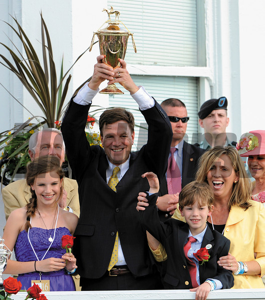 Trainer Graham Motion hold the winner's trophy alofter after Animal Kingdon ridden by jockey John Velazquez wins the 137th running of the Kentucky Derby at Churchill Downs in Louisville, KY May 7, 2011.   <br /> Photo by: Skip Dickstein