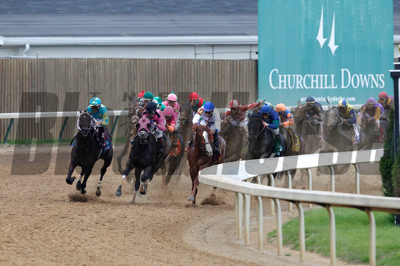 The field came around the far turn in the 137th running of the Kentucky Derby (G. I) at Churchill Downs on May 7, 2011. Animal Kingdom (back, with red cap), won the race. Photo by Crawford Ifland.