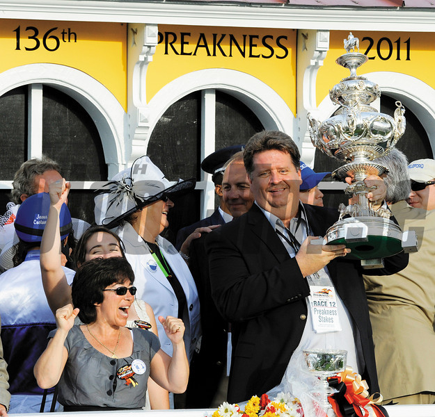 Trainer Dale Romans raises the trophy in the winner's circle after winning the 136 running of The Preakness at Pimlico Race Course May 21, 2011.     <br /> Photo by: Skip Dickstein