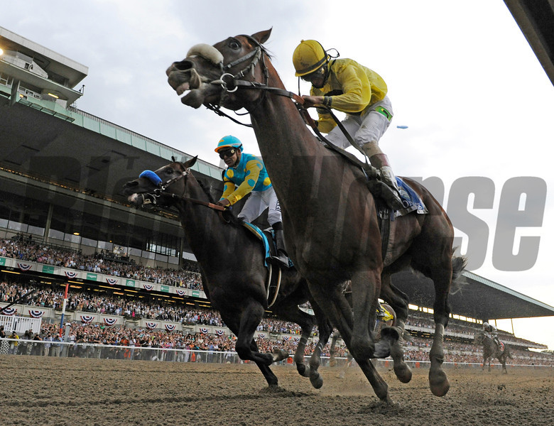 Union Rags comes up the rail, right with jockey John Velazquez to beat Paynter with Mike Smith to win the 144th running of The Belmont Stakes at Belmont Park in Elmont, N.Y. June 9, 2012.<br /> Photo by Skip Dickstein
