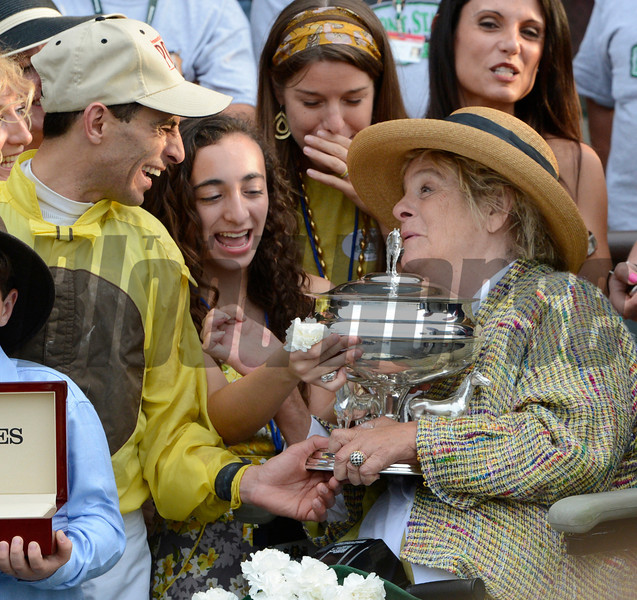 Union Rags owner Phyllis Wyeth, right holds the winning owner's trophy with the aid of jockey John Velazquez, left after her horse Union Rags won the 144th running of The Belmont Stakes at Belmont Park in Elmont, N.Y. June 9, 2012.<br /> Photo by Skip Dickstein