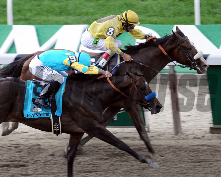 Union Rags w/John Velazquez up get a head in front of Paynter w/Mike Smith up to win the 144 Running of the Belmont Stakes at Belmont Park on June 9, 2012.<br /> Photo by Chad Harmon