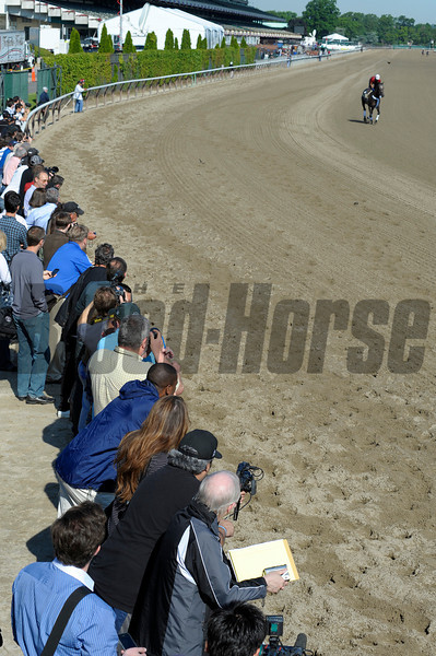 Caption:  Media line up on the rail to watch Belmont Stakes contenders on the track<br /> Belmont Park, June 7, 2012, Elmont, N.Y.<br /> Training hours activity on the track and at the barn.<br /> Photo by Anne M. Eberhardt