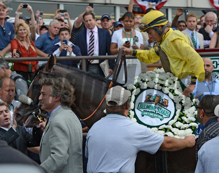 Union Rags  with jockey John Velazquez enters the winner's circle and gets the ceremonial blanket of carnations  after beating Paynter with Mike Smith to win the 144th running of The Belmont Stakes at Belmont Park in Elmont, N.Y. June 9, 2012.<br /> Photo by Skip Dickstein