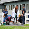Caption:  I'll Have Another has wraps put on his legs. Trainer Doug O'Neill puts wrap on front left leg (yellow cap)<br /> Belmont Park, June 4, 2012, Elmont, N.Y.<br /> Horses on the track in the morning, grazing, and trainers/connections talking and watching their horses.<br /> Belmont2012 Works1 6_4_12 image601<br /> Photo by Anne M. Eberhardt