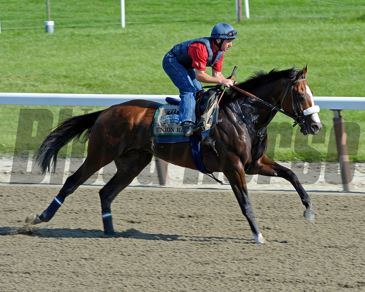 Caption:  Union Rags with Peter Brette<br /> Belmont Park, June 7, 2012, Elmont, N.Y.<br /> Training hours activity on the track and at the barn.<br /> Photo by Anne M. Eberhardt