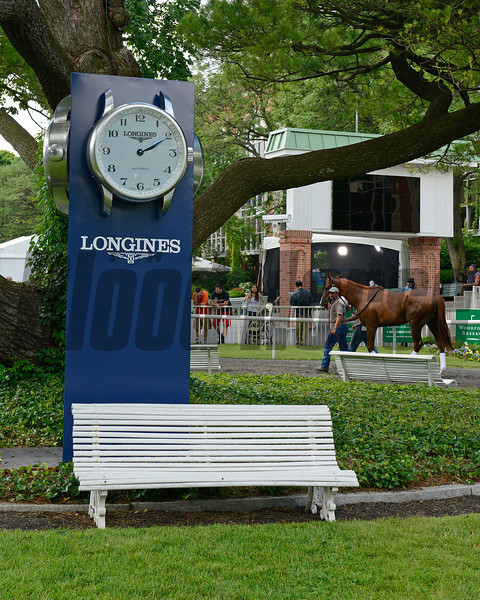 Caption:  Longines sponsorship sign in paddock as Belmont Stakes contender Dullahan schools in the paddock.<br /> Belmont Park, June 7, 2012, Elmont, N.Y.<br /> Training hours activity on the track and at the barn.<br /> Photo by Anne M. Eberhardt
