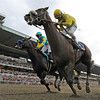Union Rags comes up the rail, right with jockey John Velazquez to beat Paynter with Mike Smith to win the 144th running of The Belmont Stakes at Belmont Park in Elmont, N.Y. June 9, 2012.  <br /> Photo by Skip Dickstein
