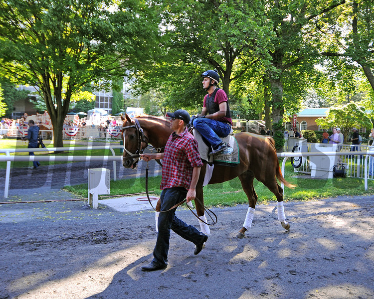 Kentucky Derby and Preakness winner I'll Have Another and exercise rider Jonny Garcia, being led to the Belmont paddock Sunday morning by groom Benjamin Perez...<br /> © 2012 Rick Samuels/The Blood-Horse