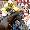 Caption: Velazquez cools off Union Rags in the winners circle.<br /> Union Rags, on rail, with John Velazquez up wins the Belmont Stakes (gr. I) with Paynter and Mike Smith in second.<br /> Belmont Park, June 9, 2012, Elmont, N.Y.<br /> Photo by Anne M. Eberhardt