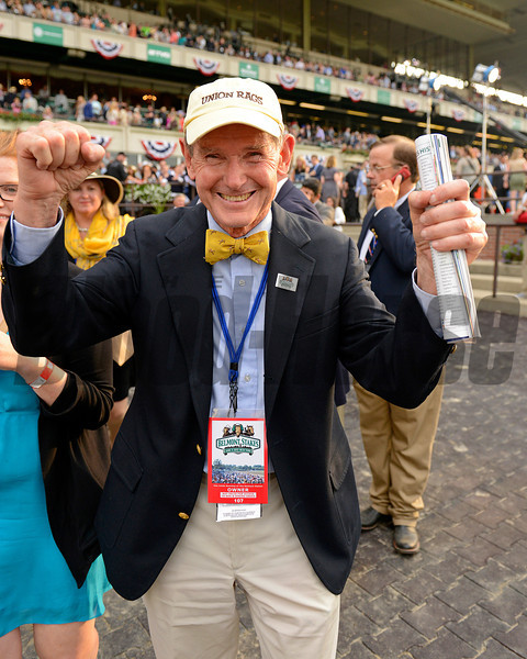 Caption: Russell Jones with Union Rags celebrates in the winner's circle.<br /> Union Rags wins the Belmont.<br /> Belmont Park, June 9, 2012, Elmont, N.Y.<br /> Photo by Anne M. Eberhardt