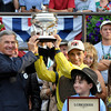 Caption: Trophy pres; trainer Michael Matz and jockey John Velazquez<br /> Belmont Park, June 9, 2012, Elmont, N.Y.<br /> Photo by Anne M. Eberhardt