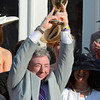 Owner J. Paul Reddam holds the winner's trophy aloft after his horse I'll Have Another won  the 138th running of the Kentucky Derby in Louisville, KY May 5, 2012.<br /> Photo by Skip Dickstein