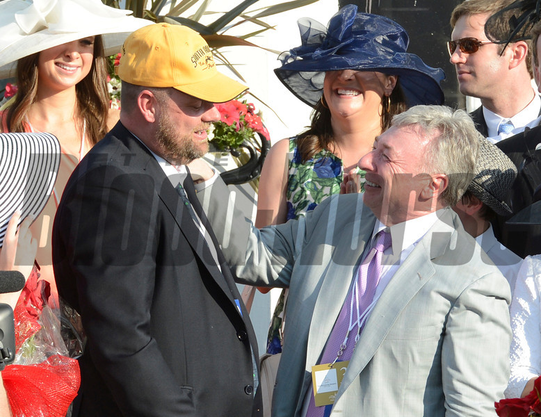 Trainer Doug O'Neill left is greeted by owner J. Paul Reddam in the winner's circle after I'll Have Another won  the 138th running of the Kentucky Derby in Louisville, KY May 5, 2012  Photo by: Skip Dickstein