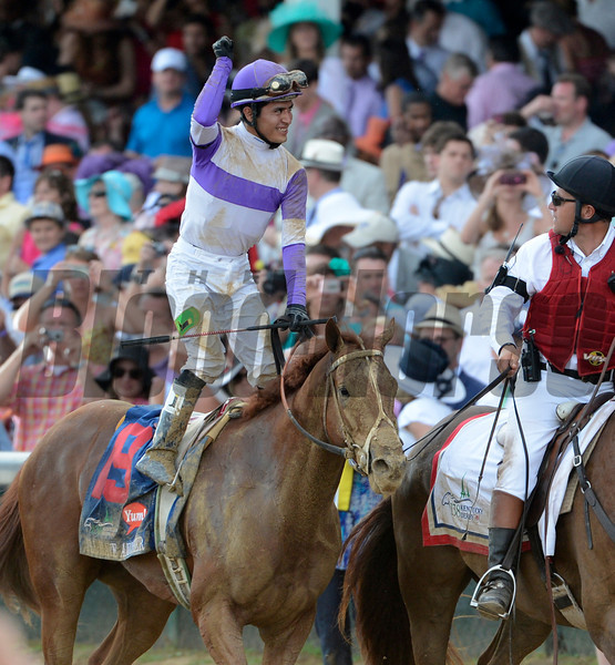jockey Mario Gutierrez stands up on I'll Have Another after wining  the 138th running of the Kentucky Derby in Louisville, KY May 5, 2012. <br /> Photo by Skip Dickstein.