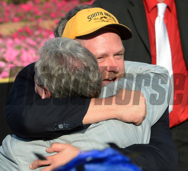 Trainer Doug O'Neill, right embraces  owner J. Paul Reddam, after  I'll Have Another won  the 138th running of the Kentucky Derby in Louisville, KY May 5, 2012  <br /> Photo by: Skip Dickstein