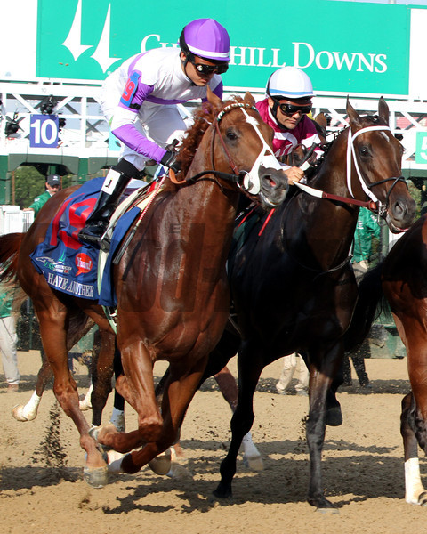 I'll Have Another w/Mario Gutierrez up and Sabercat w/Corey Nakatani up get away from the gate during the running of the 138th Kentucky Derby at Churchill Downs on May 5, 2012.<br /> Photo by Chad Harmon.