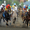 First time by in the Kentucky Derby...<br /> L-R Trinniberg, Hansen, Bodemeister<br /> Eventual winner I'll Have Another is on the far left with the blue cap.<br /> © 2012 Rick Samuels/The Blood-Horse