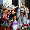 Owner J. Paul Reddam holds up the winner's trophy after his horse I'll Have Another won  the 138th running of the Kentucky Derby in Louisville, KY May 5, 2012.  With Reddam is trainer Doug O'Neill, left and jockey Mario Gutierrez.<br /> Photo by: Skip Dickstein