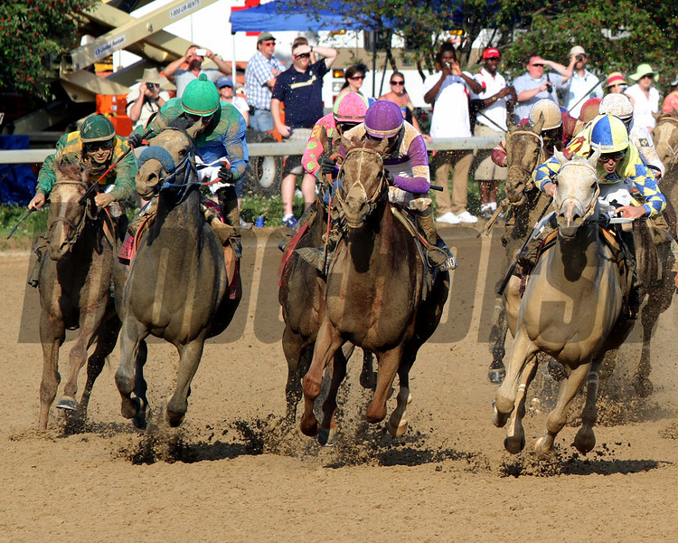 From Left to Right Dullahan w/Kent Desormeaux, Creative Cause w/Joel Rosario, I'll Have Another w/Mario Gutierrez, and Hansen w/Ramon Dominguez  come around the final turn in the 138th Running of the Kentucky Derby at Churchill Downs on May 5, 2012.<br /> Photo by Chad Harmon