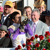 Winning jockey Mario Gutierrez kisses the winner's trophy as owner J. Paul Reddam is all smiles after I'll Have Another won  the 138th running of the Kentucky Derby in Louisville, KY May 5, 2012.<br /> Photo by Skip Dickstein.