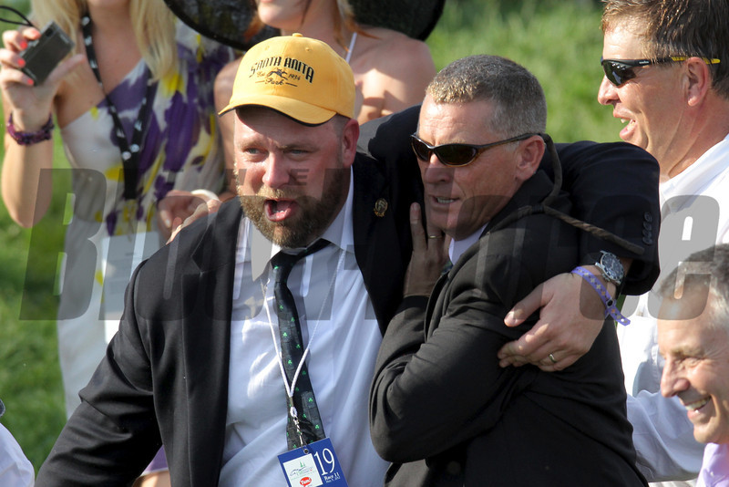 Trainer Doug O'Neill and connections head towards the winner's circle.<br /> Photo by Crawford Ifland.