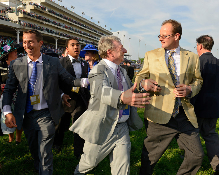 On the way to the winners circle, owner Paul Reddam (center)<br /> I'll Have Another with Mario Gutierrez up wins the Kentucky Derby presented by Yum<br /> at Churchill Downs near Louisville, Ky. on May 5, 2012.<br /> Photo by Anne M. Eberhardt