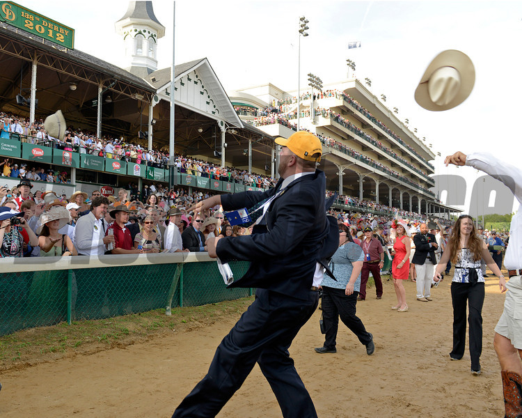 Caption:  Doug O'Neill throws hat into crowd after winning Derby<br /> I'll Have Another with Mario Gutierrez up wins the Kentucky Derby presented by Yum<br /> at Churchill Downs near Louisville, Ky. on May 5, 2012.<br /> DErby4  image866<br /> PHoto by Anne M. Eberhardt