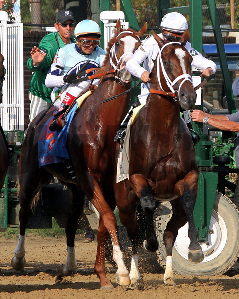 Todd Pletcher trained El Padrino and Gemologist bump at the start of the 138th Running of the Kentucky Derby at Churchill Downs on May 5, 2012.<br /> Photo by Chad Harmon