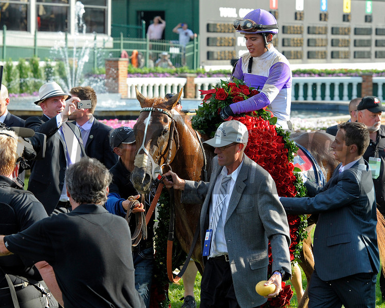 Caption:  Dennis O'Neill walks the horse into the winners circle<br /> I'll Have Another with Mario Gutierrez up wins the Kentucky Derby presented by Yum<br /> at Churchill Downs near Louisville, Ky. on May 5, 2012.<br /> DErby1  image974<br /> PHoto by Anne M. Eberhardt