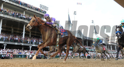 I'll Have Another with jockey Mario Gutierrez up, left out  dueled Bodemeister with jockey Mike Smith to the win in the 138th running of the Kentucky Derby in Louisville, KY May 5, 2012. Photo by Skip Dickstein.