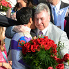 Jockey Mario Gutierrez gives a kiss to owner J. Paul Reddam, right I'll Have Another won  the 138th running of the Kentucky Derby in Louisville, KY May 5, 2012.<br /> Photo by Skip Dickstein.