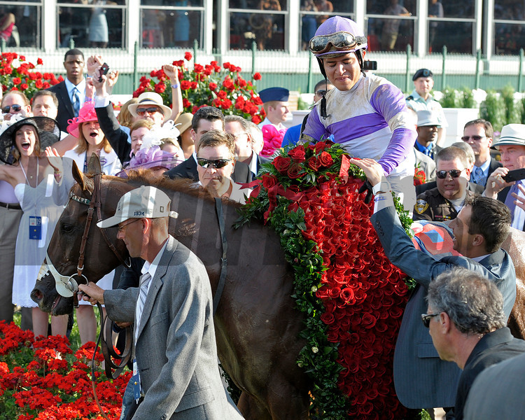 Caption:  Dennis O'Neill walks the horse into the winners circle<br /> I'll Have Another with Mario Gutierrez up wins the Kentucky Derby presented by Yum<br /> at Churchill Downs near Louisville, Ky. on May 5, 2012.<br /> DErby1  image979<br /> PHoto by Alex M. Eberhardt