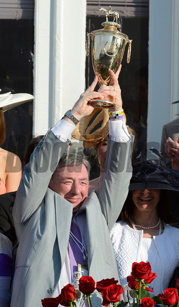Owner J. Paul Reddam holds the winner's trophy aloft after his horse I'll Have Another won  the 138th running of the Kentucky Derby in Louisville, KY May 5, 2012  <br /> Photo by: Skip Dickstein