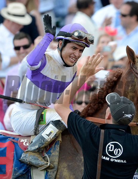 Jockey Mario Gutierrez gives some high fives on I'll Have Another after wining  the 138th running of the Kentucky Derby in Louisville, KY May 5, 2012.<br /> Photo by Skip Dickstein.