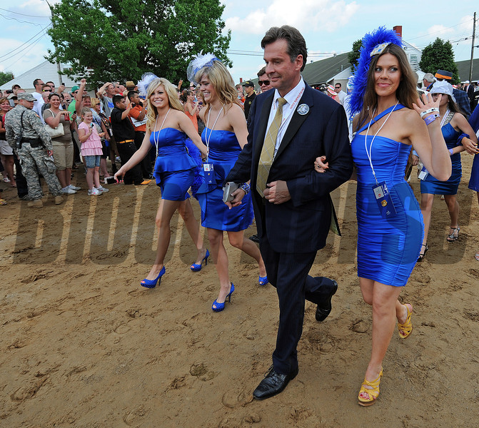 Dr. Kendall Hansen, owner of Hansen, and some friends, leaving the barn and heading to the paddock for the Kentucky Derby....<br /> © 2012 Rick Samuels/The Blood-Horse