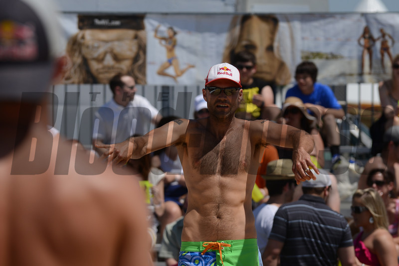 2008 Olympic  gold medalists Todd Rogers and Phil Dalhausser warm up before the NVL final tournament game in the 2012 Preakness infield