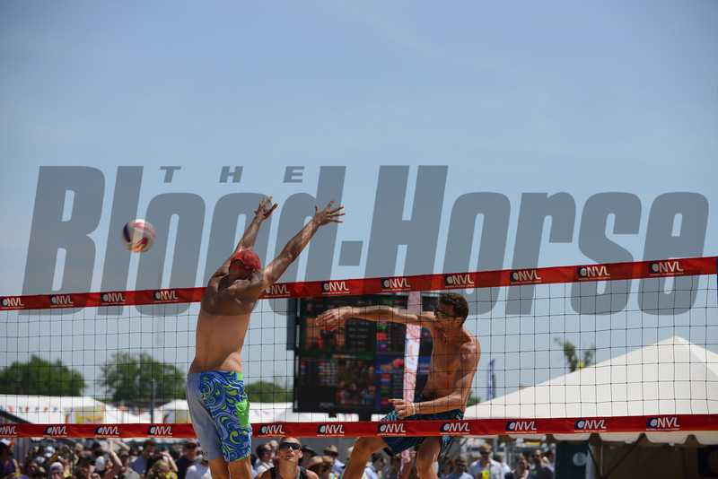 Ryan Doherty spikes against Phil Dalhausser at the NVL final tournament game in the 2012 Preakness infield