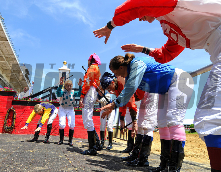 The Lady Legends riders bowing to Barbbara Jo Rubin (orange silks) during the opening ceramonies...<br /> © 2012 Rick Samuels/The Blood-Horse