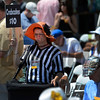 A Crab Cakes salesperson on Preakness Day at Pimlico Race Course in Baltimore, MD May 19, 2012.  Photo by Skip Dickstein